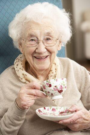Senior Woman Enjoying Cup Of Tea At Home Stock Photo - 9911307