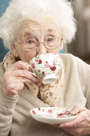 Senior Woman Enjoying Cup Of Tea At Home Stock Photo - 9911330