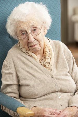 Senior Woman Looking Sad In Chair At Home Stock Photo - 9911040