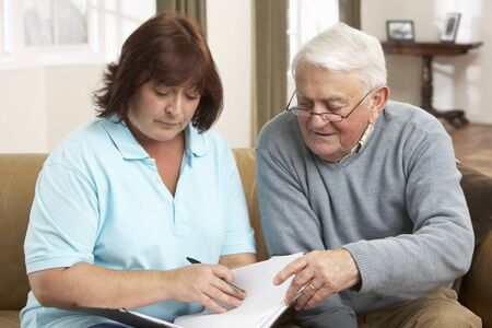 Senior Man In Discussion With Health Visitor At Home Stock Photo - 9911250