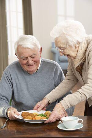 sheltered: Senior Couple Enjoying Meal Together