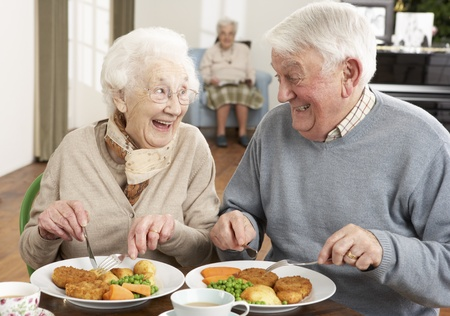 Senior Couple Enjoying Meal Together photo