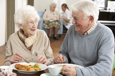 senior eating: Senior Couple Enjoying Meal Together