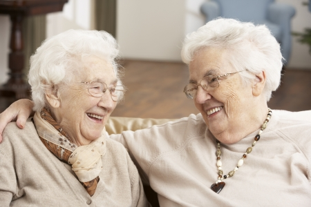 Two Senior Women Friends At Day Care Centre Stock Photo