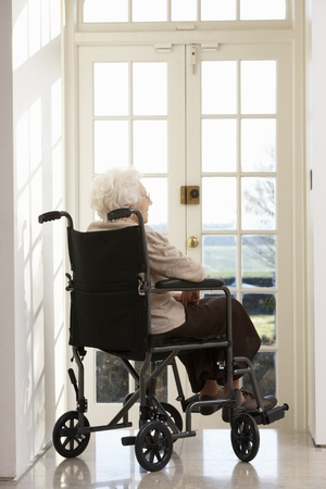 Disabled Senior Woman Sitting In Wheelchair photo