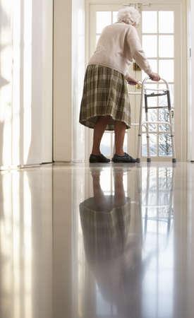 nineties: Elderly Senior Woman Using Walking Frame