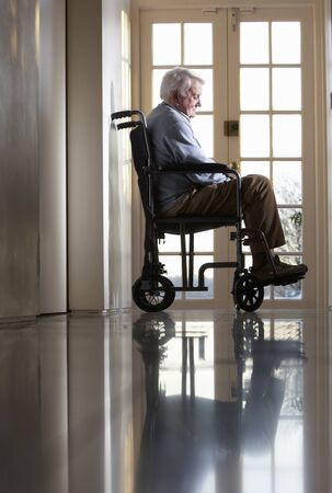 Disabled Senior Man Sitting In Wheelchair photo