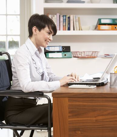 home office: Woman Working From Home Using Laptop Stock Photo
