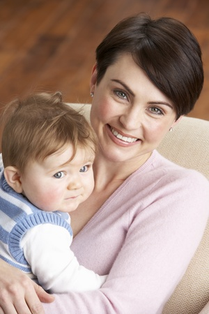 realtionship: Portrait Of Mother With Baby At Home
