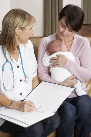 midwife: Mother With Newborn Baby Talking With Health Visitor At Home
