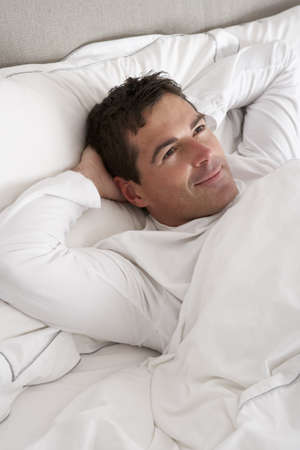 Man Relaxing In Bed Stock Photo - 9911652