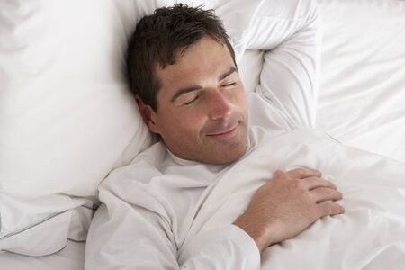 Man Sleeping Peacefully In Bed Stock Photo - 9911680