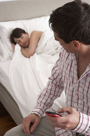 affairs: Suspicious Husband Checking Wifes Mobile Phone Whilst She Sleeps