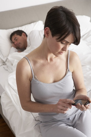 wives: Suspicious Wife Checking Husbands Mobile Phone Whilst He Sleeps