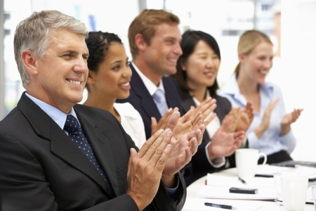 applauding: Business people clapping