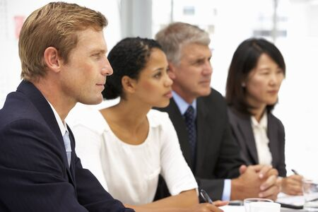 sideview: Business people in office