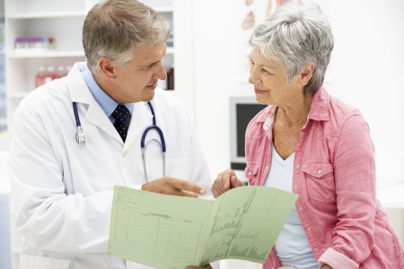 Doctor with female patient Stock Photo - 11185096
