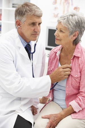 serious doctor: Doctor with female patient