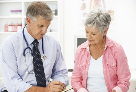 physician: Doctor with female patient