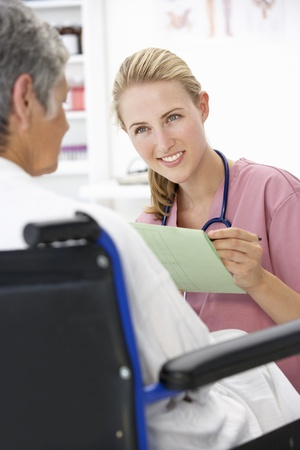 Doctor with female patient photo
