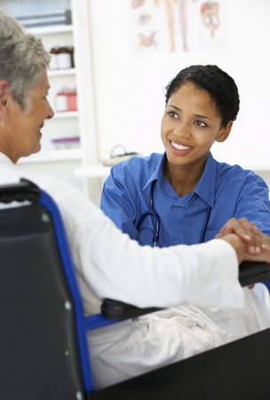 Doctor with female patient Stock Photo - 11182933