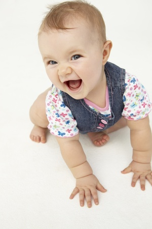 six months: Portrait of happy baby