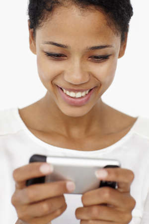Young woman using mobile phone Stock Photo - 11184082