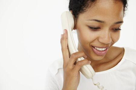 Woman talking on telephone photo