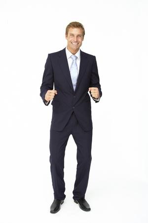 smartly: Happy, triumphant businessman