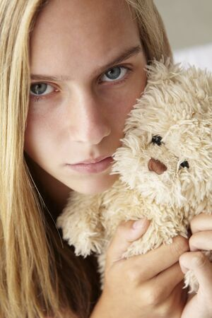 cuddly toy: Unhappy teenage girl with cuddly toy
