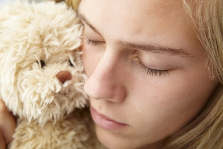 cuddly: Close up teenage girl with cuddly toy Stock Photo