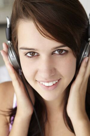 Teenage girl wearing headphones photo