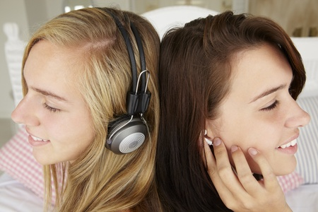 Teenage girls listening to music photo