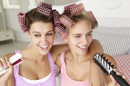 hairbrush: Teenage girls with hair in curlers Stock Photo