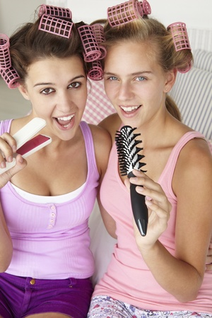 Teenage girls with hair in curlers photo