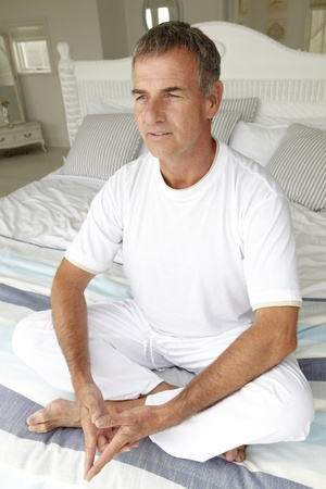 Mid age man in lotus position photo