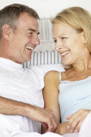 reclining: Mid age couple in love