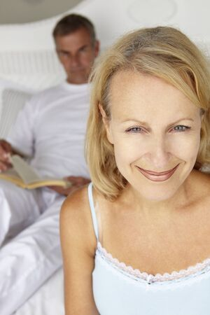 Mid age couple in bedroom photo