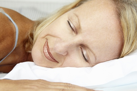 peacefully: Head and shoulders mid age woman sleeping