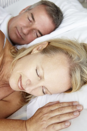 peacefully: Head and shoulders mid age couple sleeping