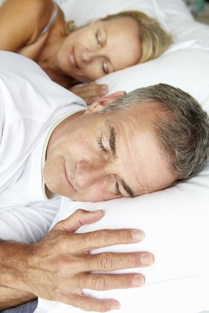 Head and shoulders mid age couple sleeping photo