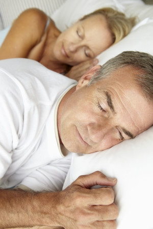 pillow sleep: Head and shoulders mid age couple sleeping