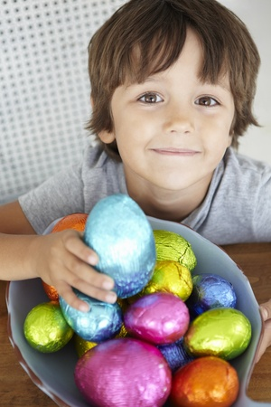 anticipating: Child with Easter eggs Stock Photo