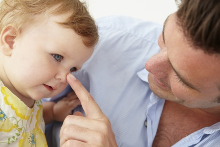 fatherhood: Doting father with baby daughter at home
