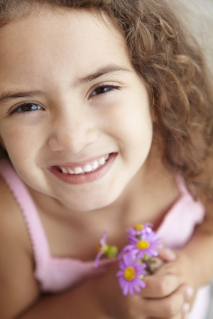 Young girl holding flowers Stock Photo - 11190993