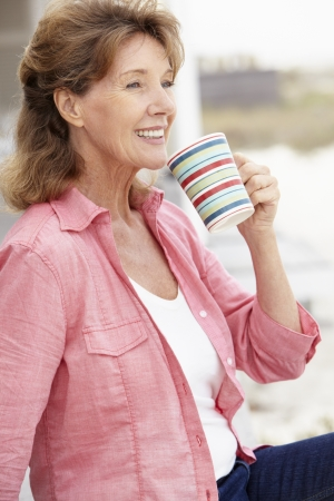 Senior woman relaxing outdoors photo