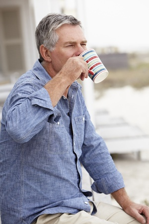 greying: Senior man relaxing outdoors