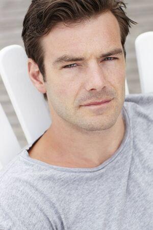 thirties portrait: Head and shoulders portrait man outdoors Stock Photo