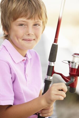 Young boy with fishing rod photo