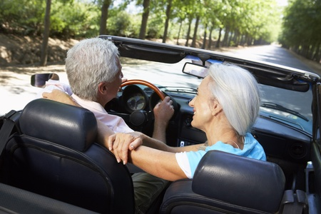 convertible car: Senior couple in sports car